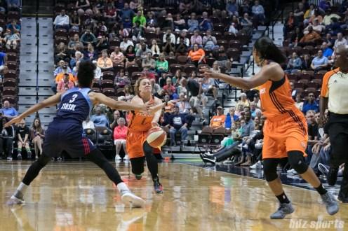 Connecticut Sun guard Rachel Banham (1) delivers a bounce pass to teammate guard Feyonda Fitzgerald (2).