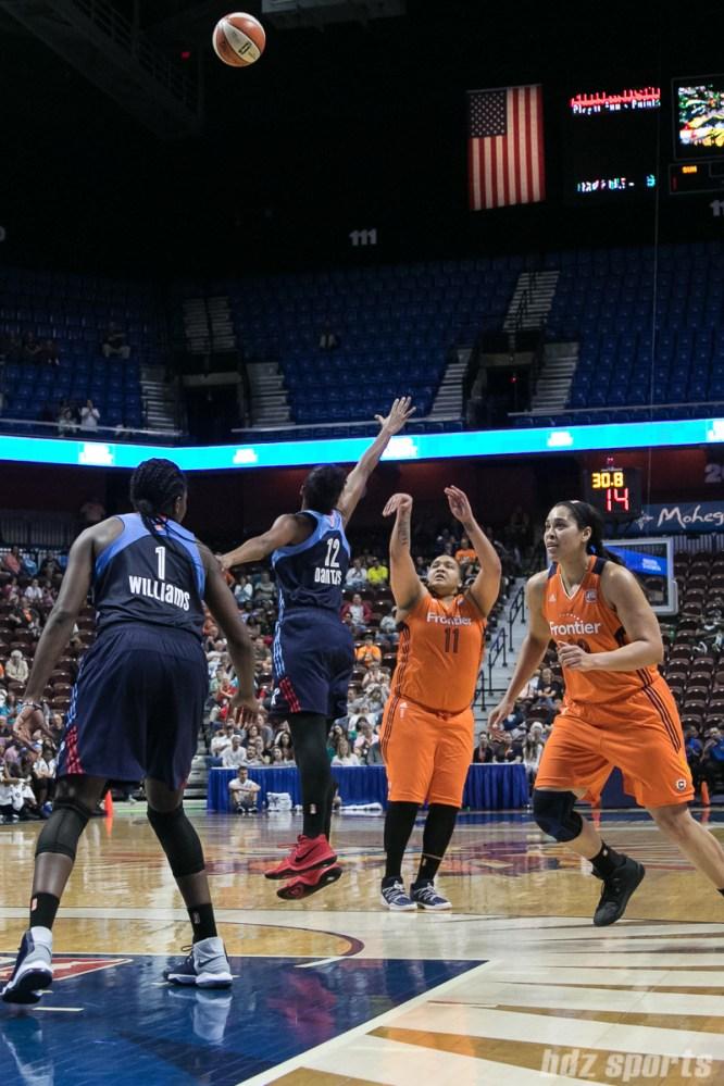 Connecticut Sun forward Danielle Adams (11) attempts a 3-point shot over the arm of Atlanta Dream forward Damiris Dantas (12).