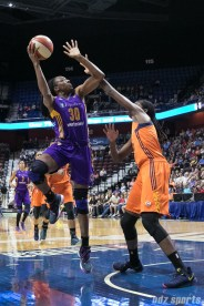 Los Angeles Sparks forward Nneka Ogwumike (30) looks to lay in the ball.