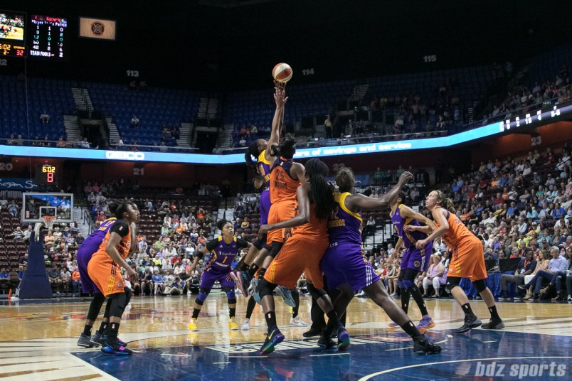 Los Angeles Sparks forward Nneka Ogwumike (30) gets her finger tips on a jump ball against Connecticut Sun forward Alyssa Thomas (25).