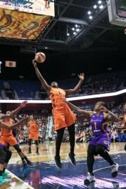Connecticut Sun forward Shekinna Stricklen (40) reaches out to grab the rebound.