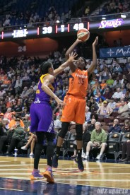 Connecticut Sun center Jonquel Jones (35) focuses on making the jump shot while being defended by Los Angeles Sparks forward Candace Parker (3).