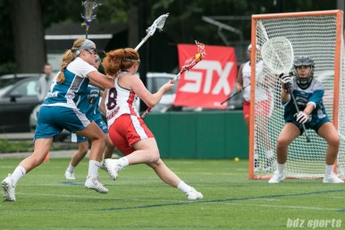 Boston Storm midfielder Hannah Murphy (8) looks to get around Philadelphia Force Kelsey McGovern (4).