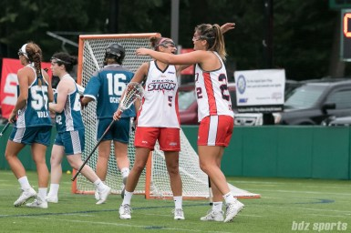 Boston Storm midfielder Tanner Guarino (5) and attacker Elisabeth Jayne (22) celebrate Jayne's goal.