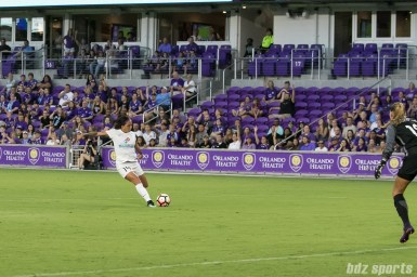 FC Kansas City forward Sydney Leroux (14) gets being the Orlando Pride backline and takes a shot on goal.