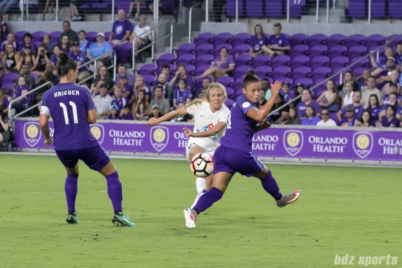 FC Kansas City forward Brittany Ratcliffe (25) rips a shot on goal between Orlando Pride defenders.