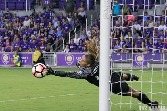 Orlando Pride goalkeeper Aubrey Bledsoe (19) pushes a shot wide of the goal post.