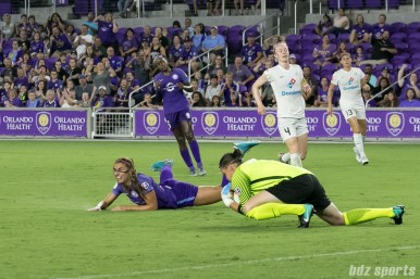 FC Kansas City goalkeeper Nicole Barnhart (18) comes up with the ball stopping Orlando Pride forward Alex Morgan (13) from getting a shot on goal.