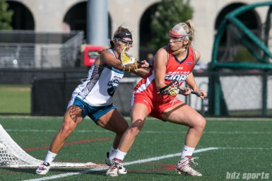 Philadelphia Force defender Katie Hersch (25) defends against Boston Storm attacker Kate Weeks (24).