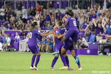 The Orlando Pride celebrate teammate Toni Pressley's (3) goal.