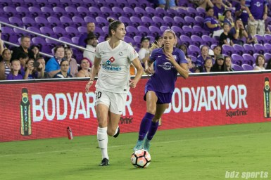 FC Kansas City midfielder Yael Averbuch (10) looks for an outlet pass as Orlando Pride forward Alex Morgan (13) give chase.