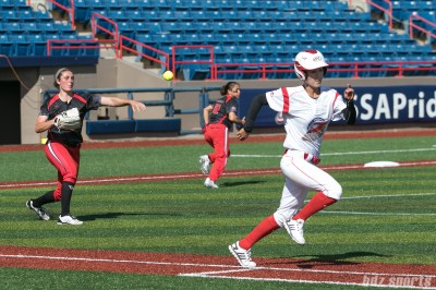 Akron Racers pitcher Jailyn Ford (12) throws out Beijing Eagles infielder Zhao Jing (23).