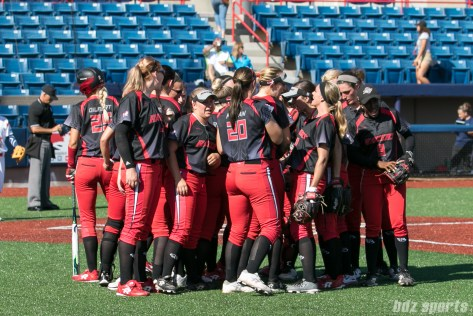 The Akron Racers huddle at the end of the inning.