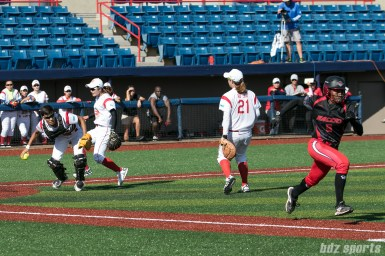 Akron Racers outfielder A.J. Andrews (9) outruns the play to first on a bunt in the third inning.