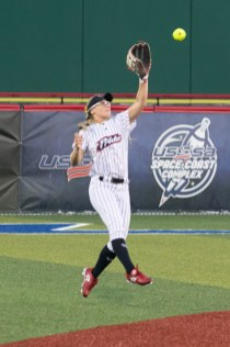USSSA Pride outfielder Kirsti Merritt (24) grabs a line drive out of the air.