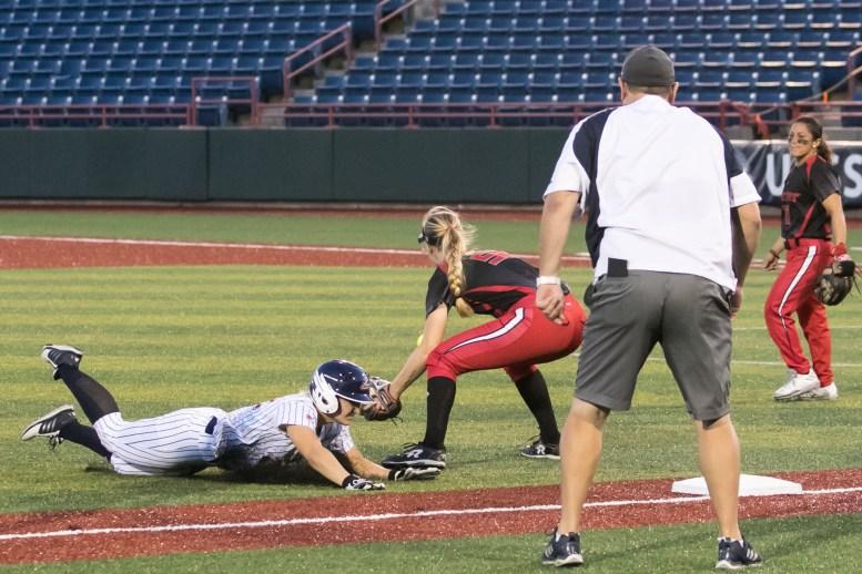 USSSA Pride utility player Hallie Wilson (22) slides safely into third base.
