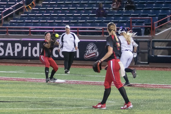 Akron Racers infielder Ashley Thomas (1) catches the ball to get the runner out at first.