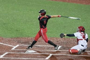 Akron Racers shortstop Sami Fagan (5) takes a swing during her turn at bat.