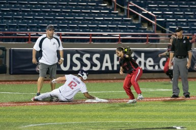 USSSA Pride outfielder Kelly Kretschman (12) beats the throw and slides safely into third base.