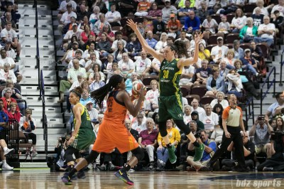 Seattle Storm forward Breanna Stewart (30) looks to block and defend against Connecticut Sun center Jonquel Jones (35) .