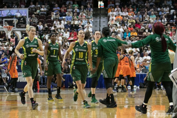 The Seattle Storm high five during a time out.