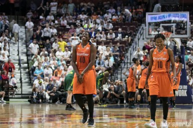 Connecticut Sun forward Shekinna Stricklen (40) and teammate guard Courtney Williams (10) grin as it looks like the Sun have locked up a win over the Seattle Storm.