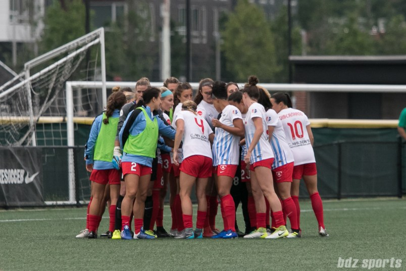 The Chicago Red Stars huddle before the start of the game.