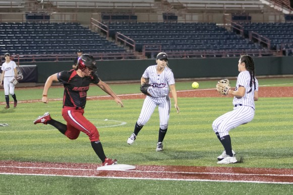Akron Racers infielder Maddy Grimm (23) beats the ball to first base.