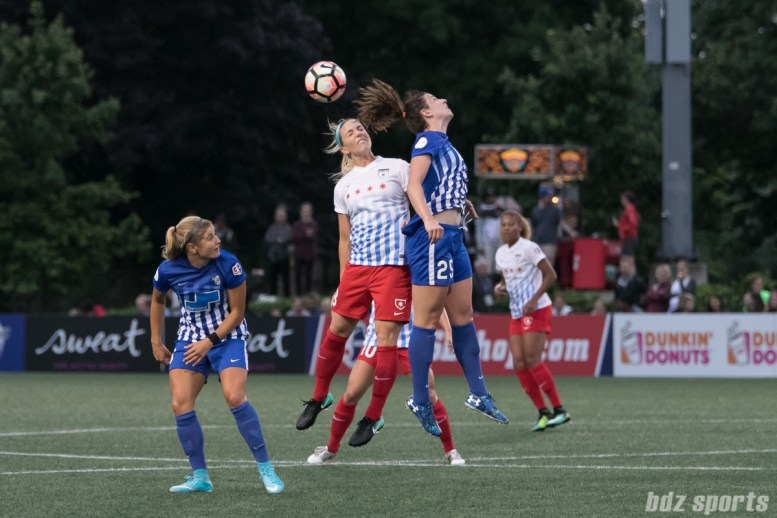 Chicago Red Stars defender Julie Ertz (8) and Boston Breakers midfielder Morgan Andrews (25) battle for a ball in the air.