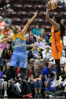 Connecticut Sun guard Courtney Williams (10) looks to shot over the arm of Chicago Sky guard Courtney Vandersloot (22).