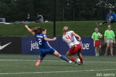Boston Breakers defender Allysha Chapman (2) slides to tackle a ball away from Chicago Red Stars midfielder Alyssa Mautz (4).