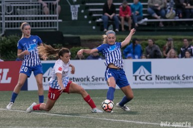 Boston Breakers defender Megan Oyster (4) lunges to get a foot on the ball.