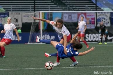 Chicago Red Stars forward Sofia Huerta (11) and Boston Breakers defender Allysha Chapman (2) get tangled up.