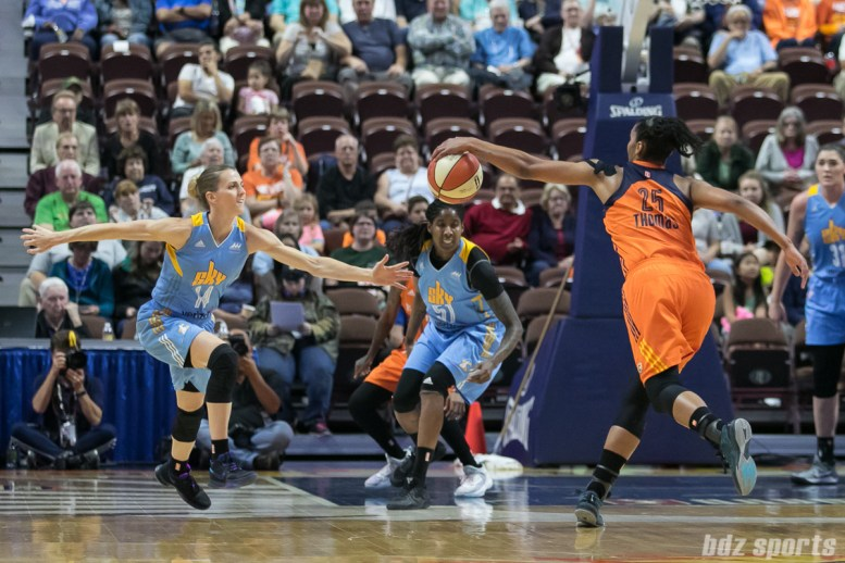 Chicago Sky guard Allie Quigley (14) and Connecticut Sun forward Alyssa Thomas (25) reach out for a loose ball.