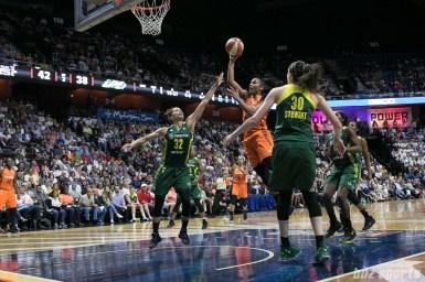 Connecticut Sun forward Alyssa Thomas (25) looks to float in a basket.