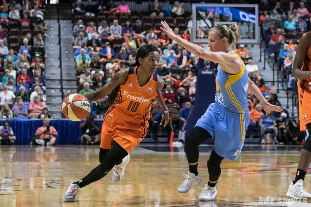 Connecticut Sun guard Courtney Williams (10) drives to the basket while being defended by Chicago Sky guard Courtney Vandersloot (22).