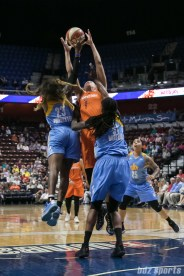 Chicago Sky guard Cappie Pondexter (23) and Connecticut Sun forward Kayla Pedersen (7) jump for a loose ball.