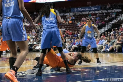 Connecticut Sun forward Kayla Pedersen (7) falls to the floor trying to gain possession of the ball.