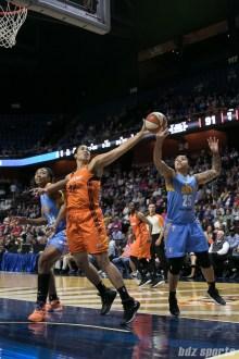 Connecticut Sun forward Brionna Jones (42) and Chicago Sky guard Makayla Epps (25) reach for a loose ball.
