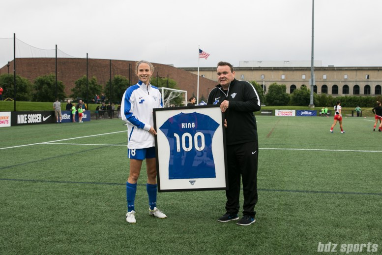 Boston Breakers captain Julie King (8) is honored with a jersey prior to the start of the game for her 100th cap with the Breakers.