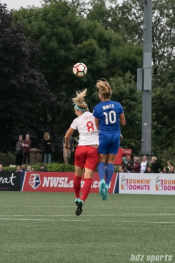 Boston Breakers midfielder Rosie White (10) challenges Chicago Red Stars defender Julie Ertz (8) for a ball in the air.