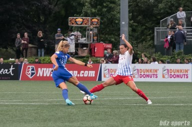 Boston Breakers midfielder Rosie White (10) looks to get by Chicago Red Stars midfielder Vanessa DiBernardo (10).
