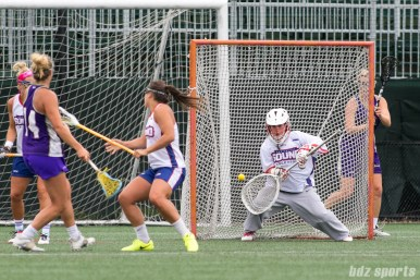 Long Island Sound goalie looks to stop the ball.