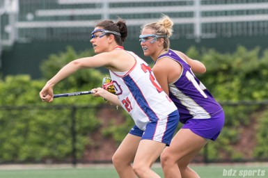 Long Island Sound midfielder Kaleigh Craig (21) takes the face off against a Baltimore Ride player.