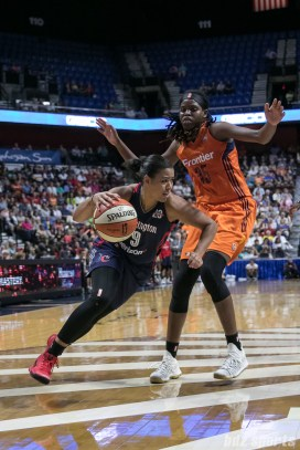 Washington Mystics guard Natasha Cloud (9) drives past Connecticut Sun center Jonquel Jones (35).