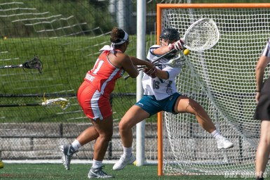 Boston Storm attacker Bre Hudgins (11) takes a shot on Philadelphia Force goalie Zoe Ochoa (16).