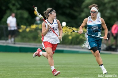 A Boston Storm player brings the ball downfield.