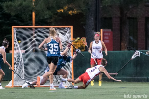 Boston Storm midfielder Tanner Guarino (5) falls to the ground as her shot hits the bck of the net.