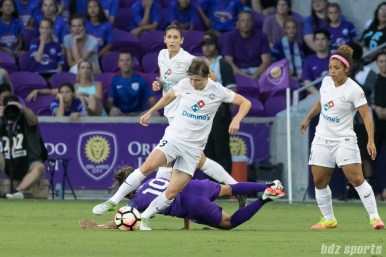 FC Kansas City defender Becca Moros (3) possesses the ball shielding off Orlando Pride forward Marta (10).