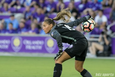 Orlando Pride goalkeeper Aubrey Bledsoe (19) throws the ball to a teammate.